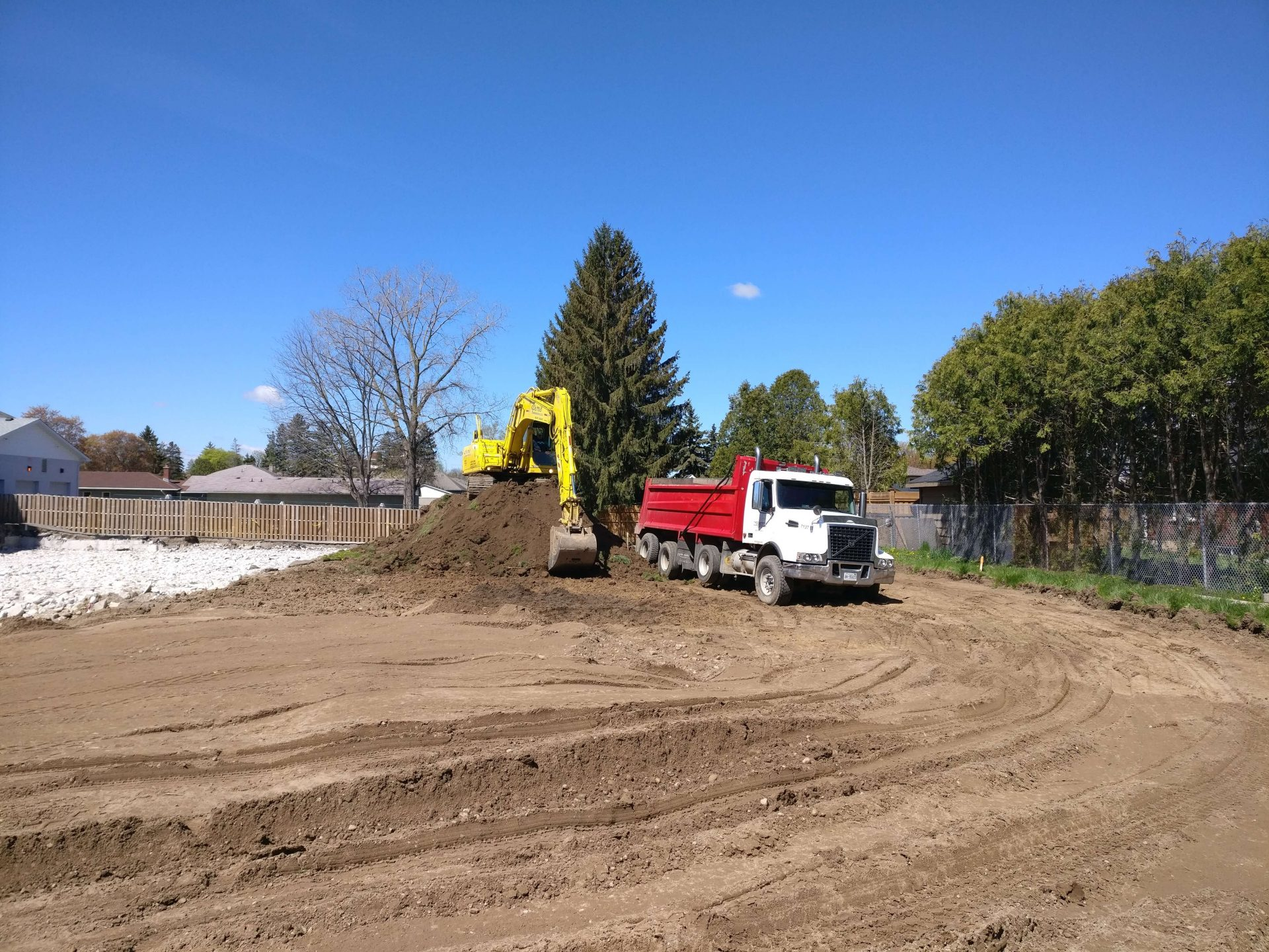 Digging process for parking lot installation
