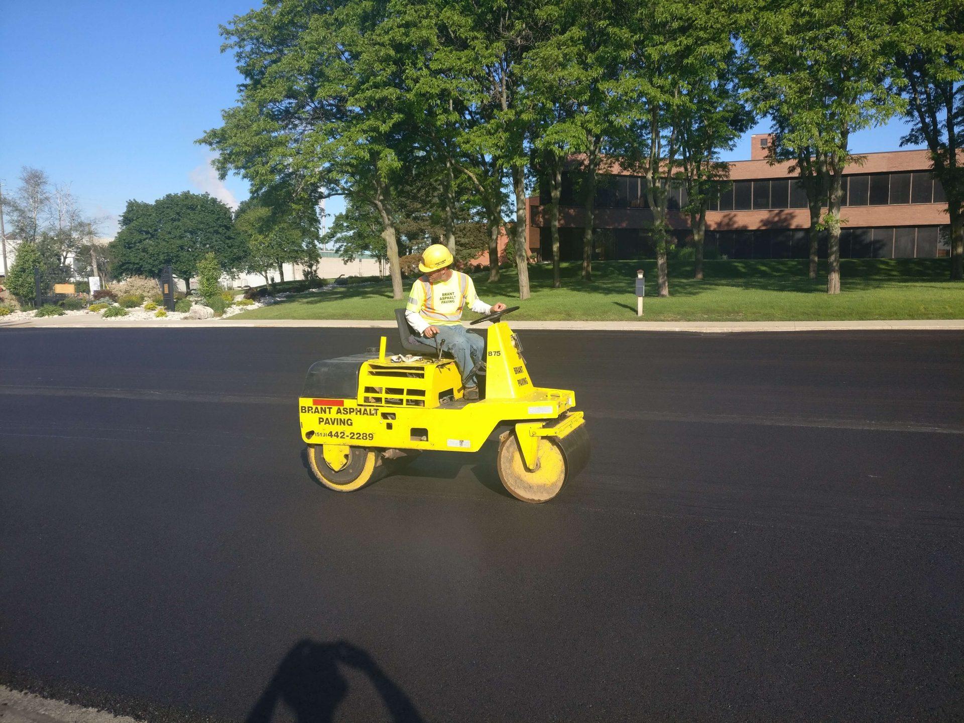 Paris Construction worker on freshly rolled asphalt