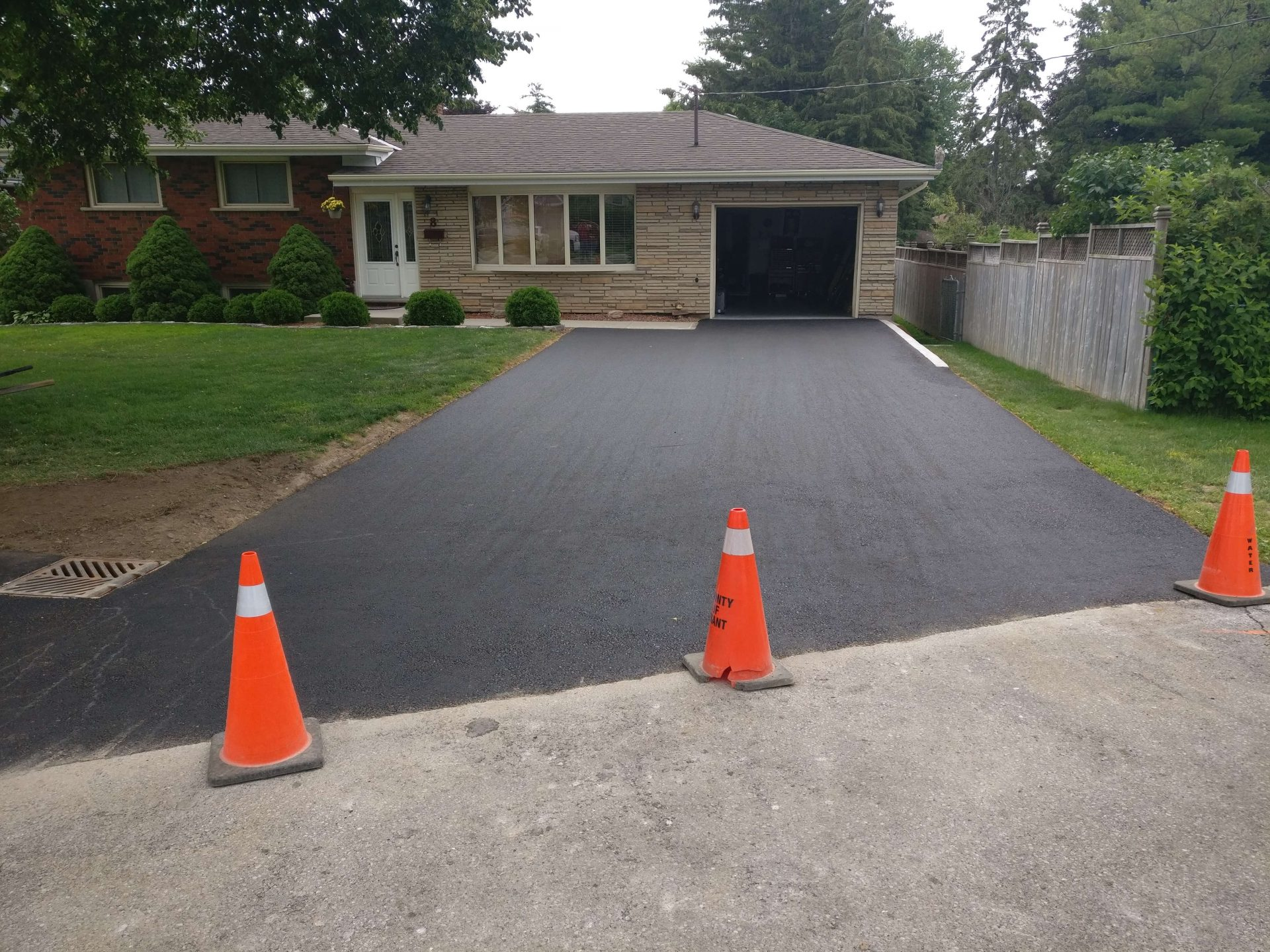 Finished driveway blocked by pylons