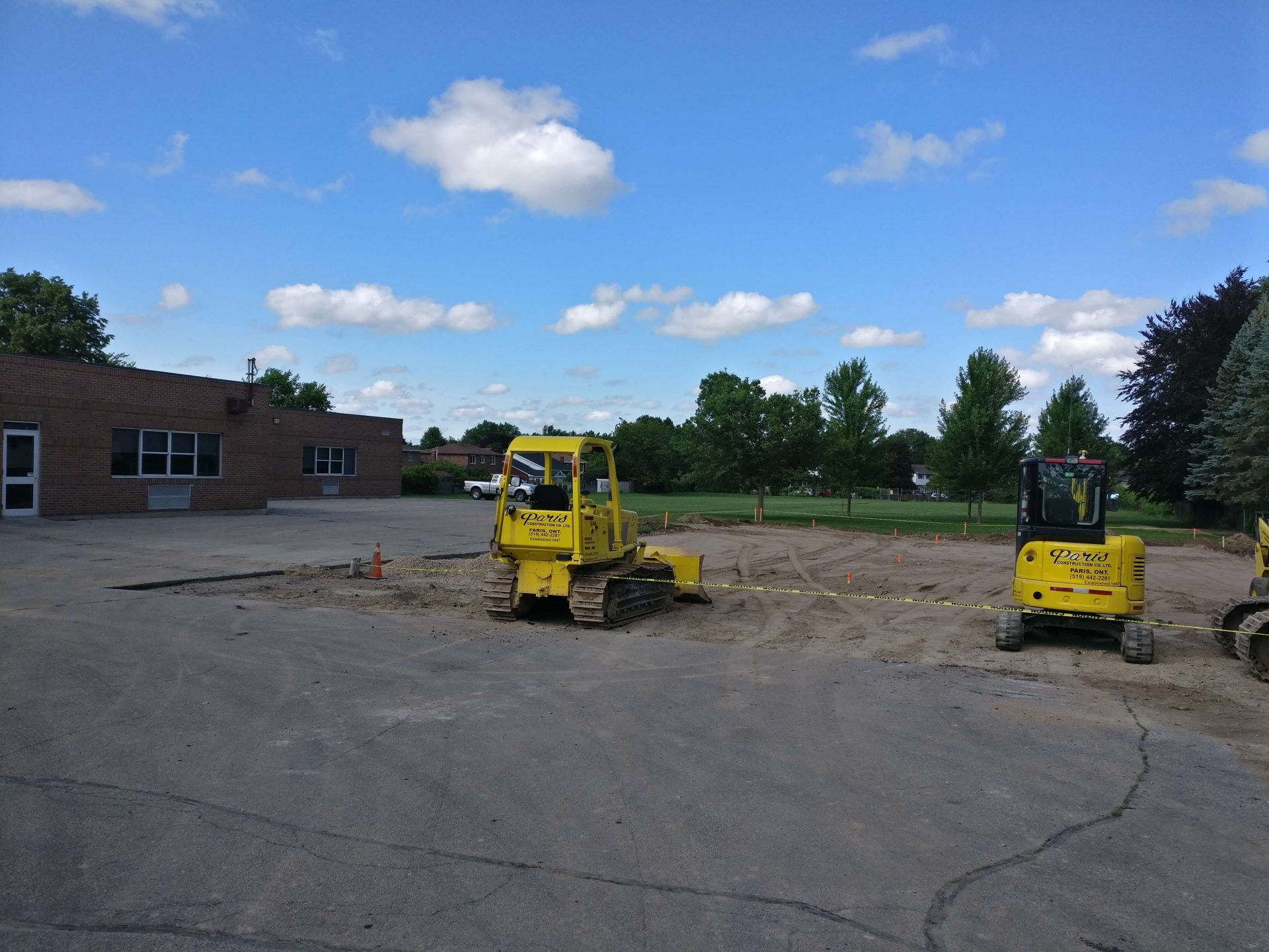 unpaved lot with construction machinery