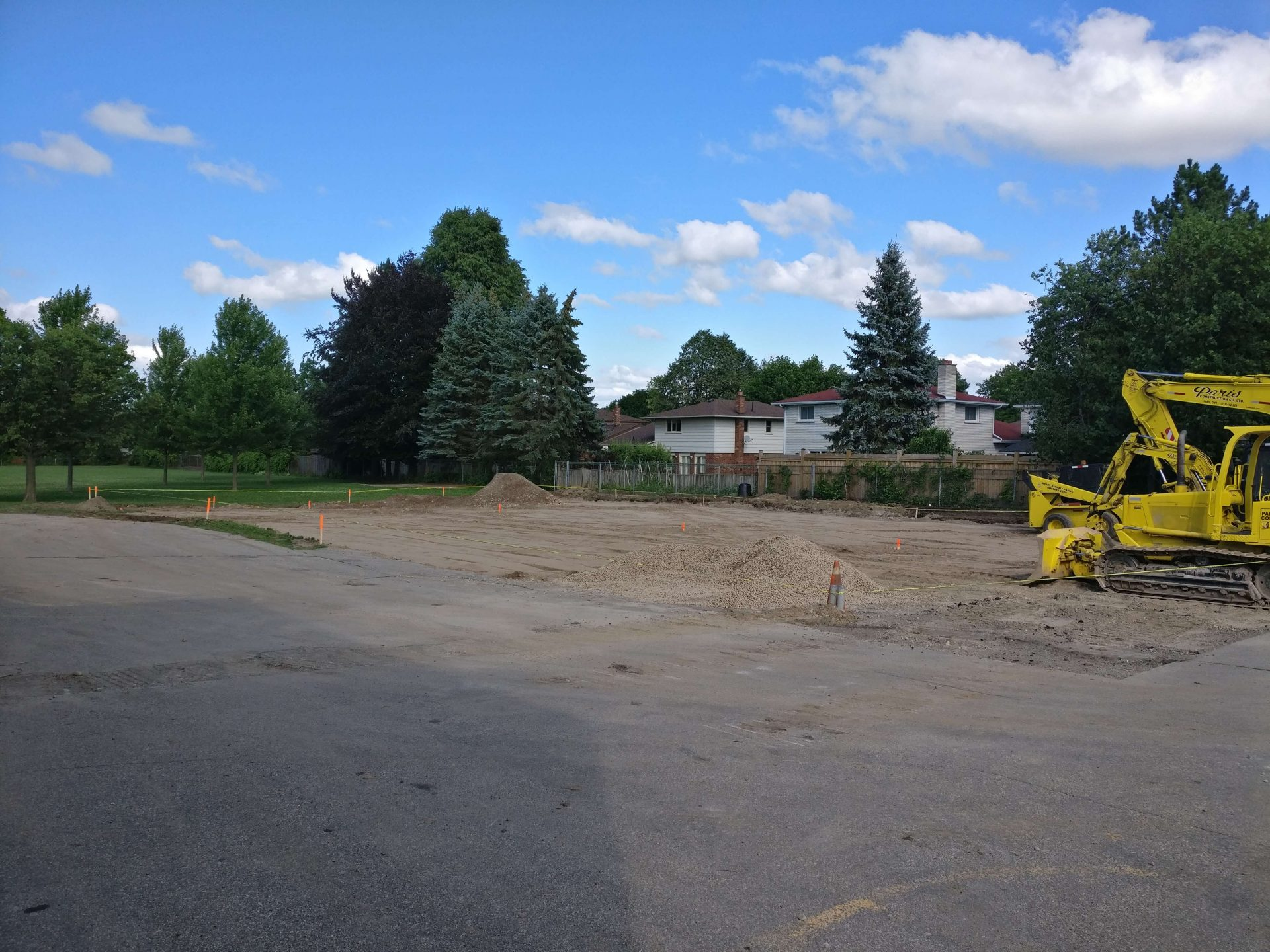 Unpaved lot with excavator