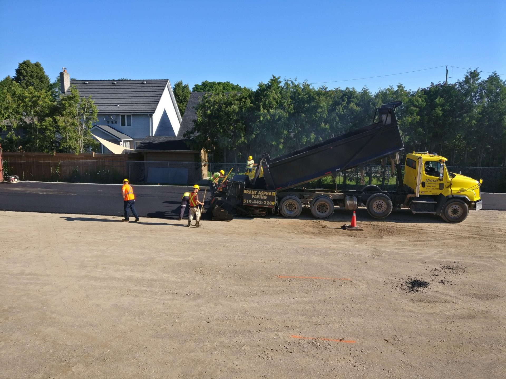Brant Asphalt truck paving back parking lot