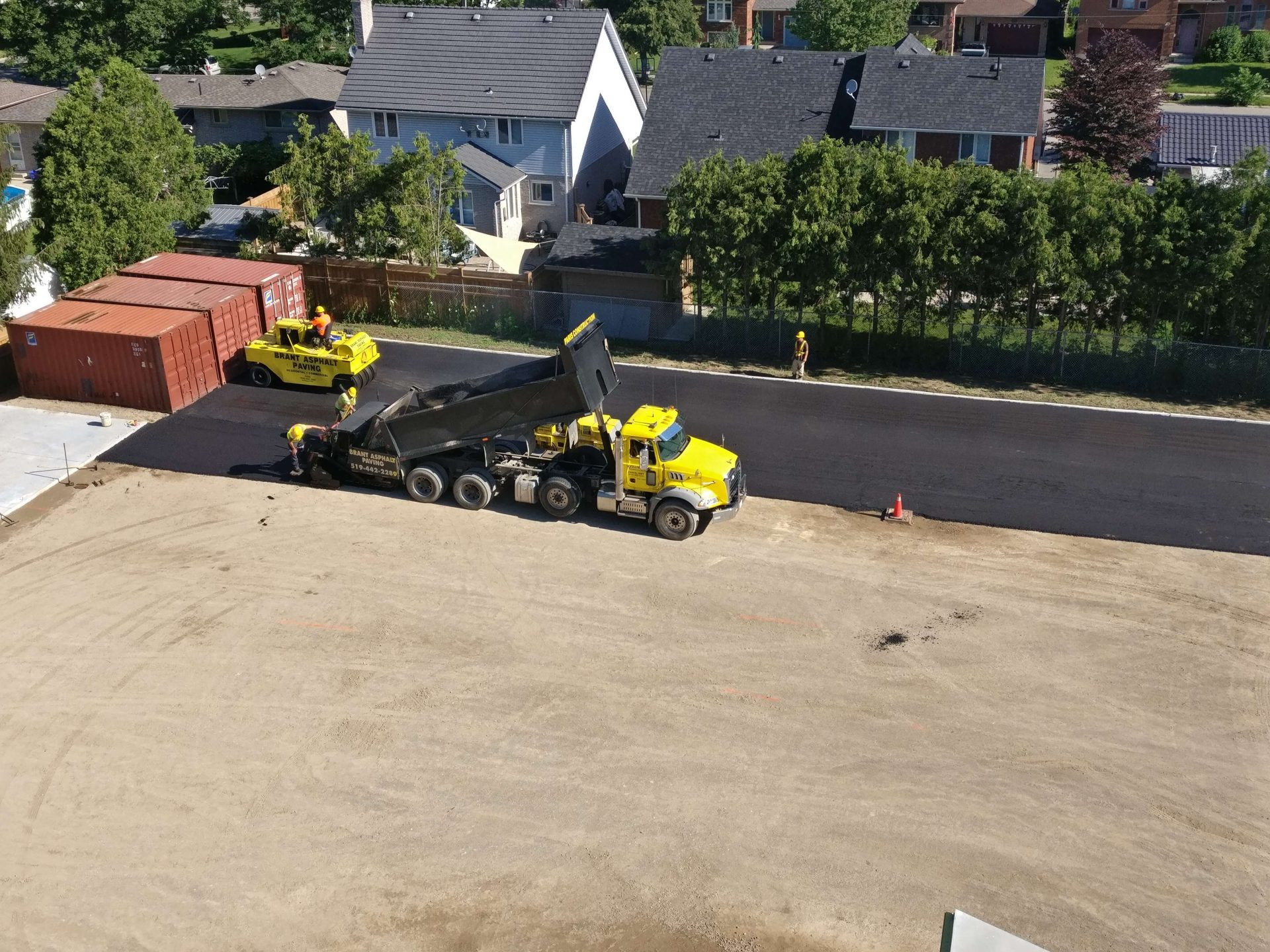 Paved asphalt strip in back parking lot