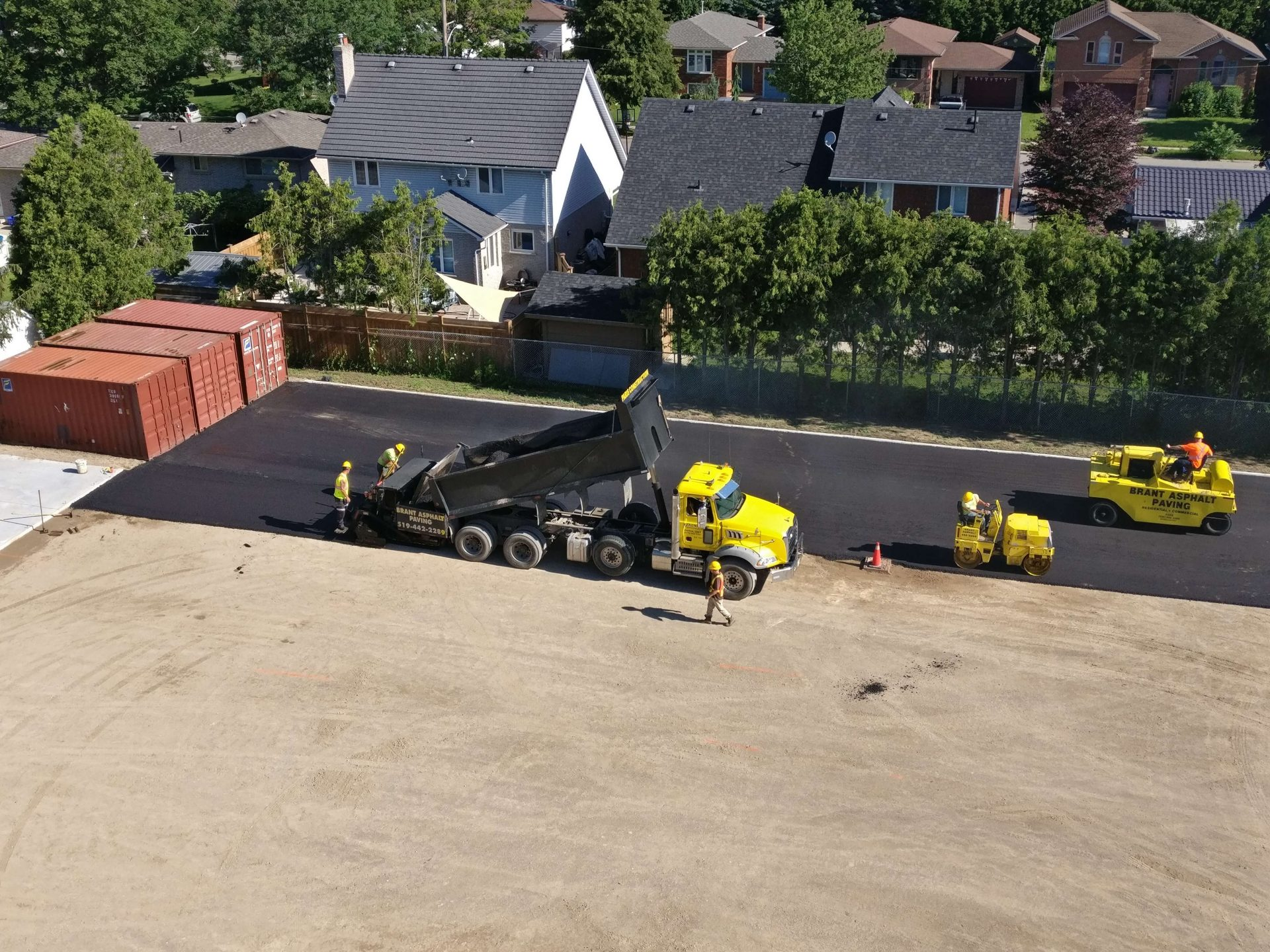 workers completing asphalt paving