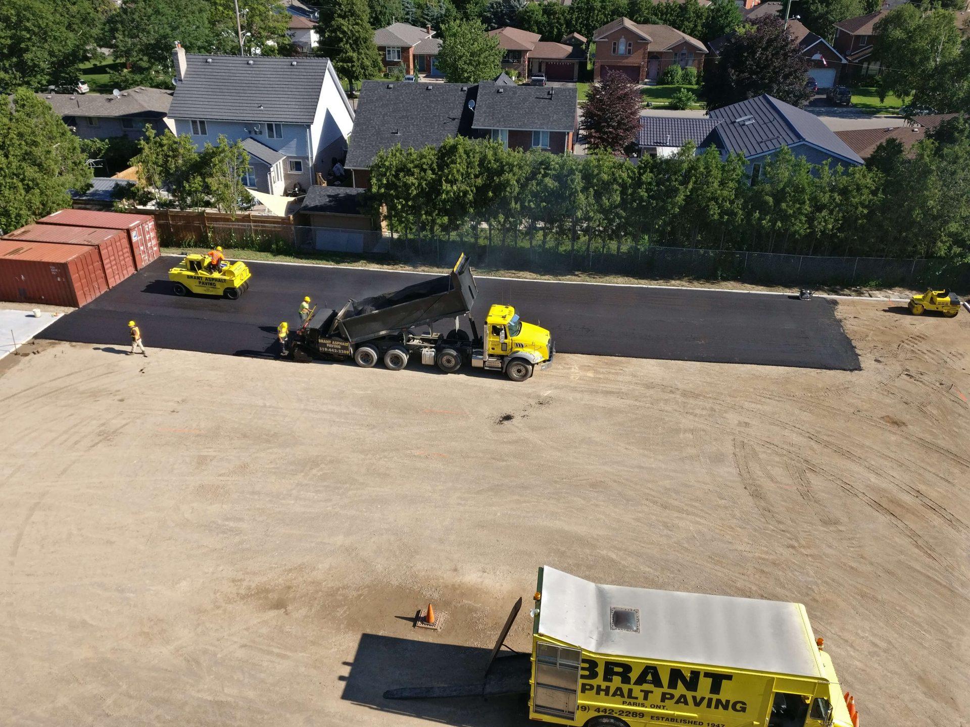 Asphalt being paved on back lot