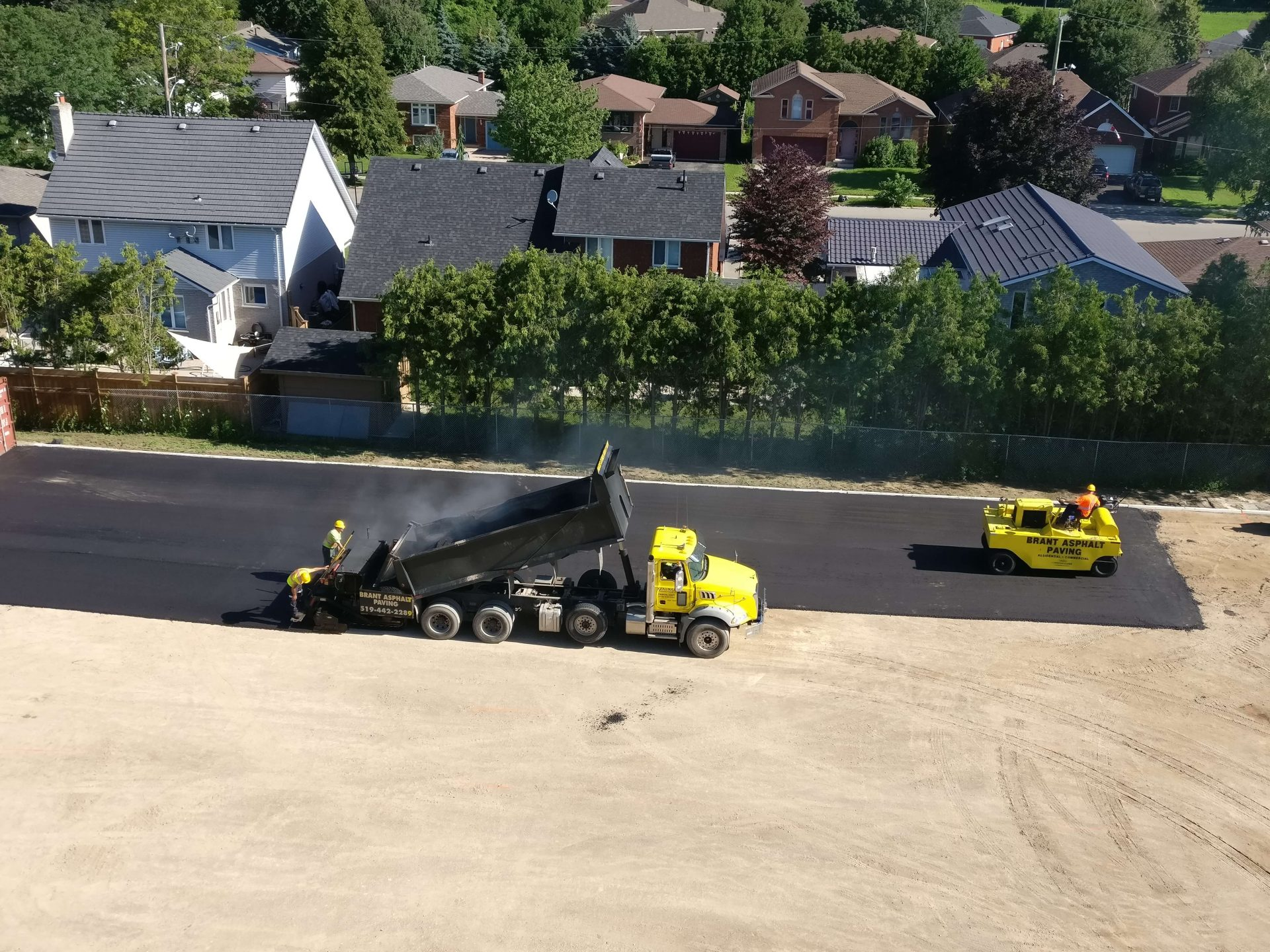 Paris construction truck dumping asphalt