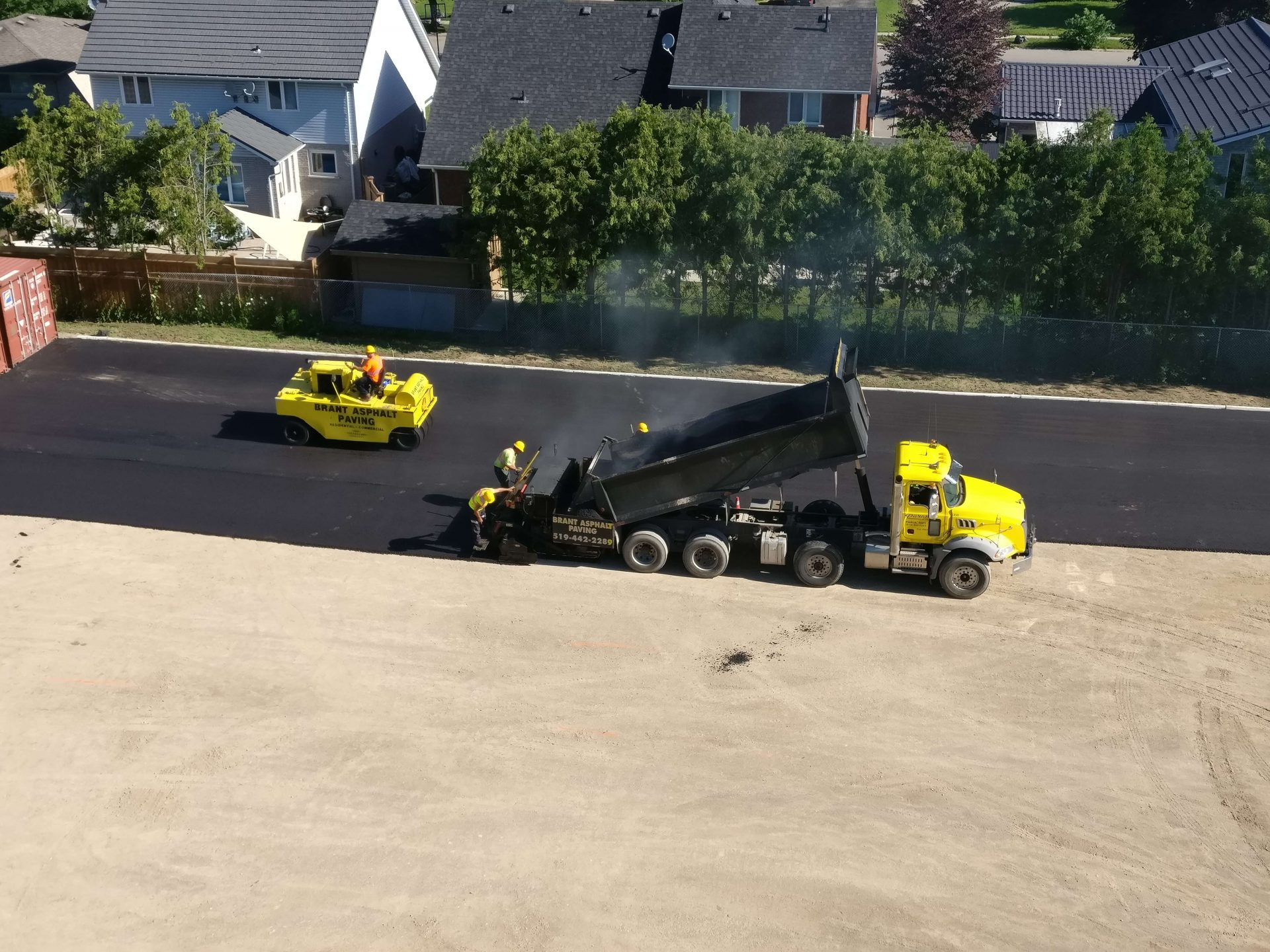 Asphalt being pressed onto new parking lot
