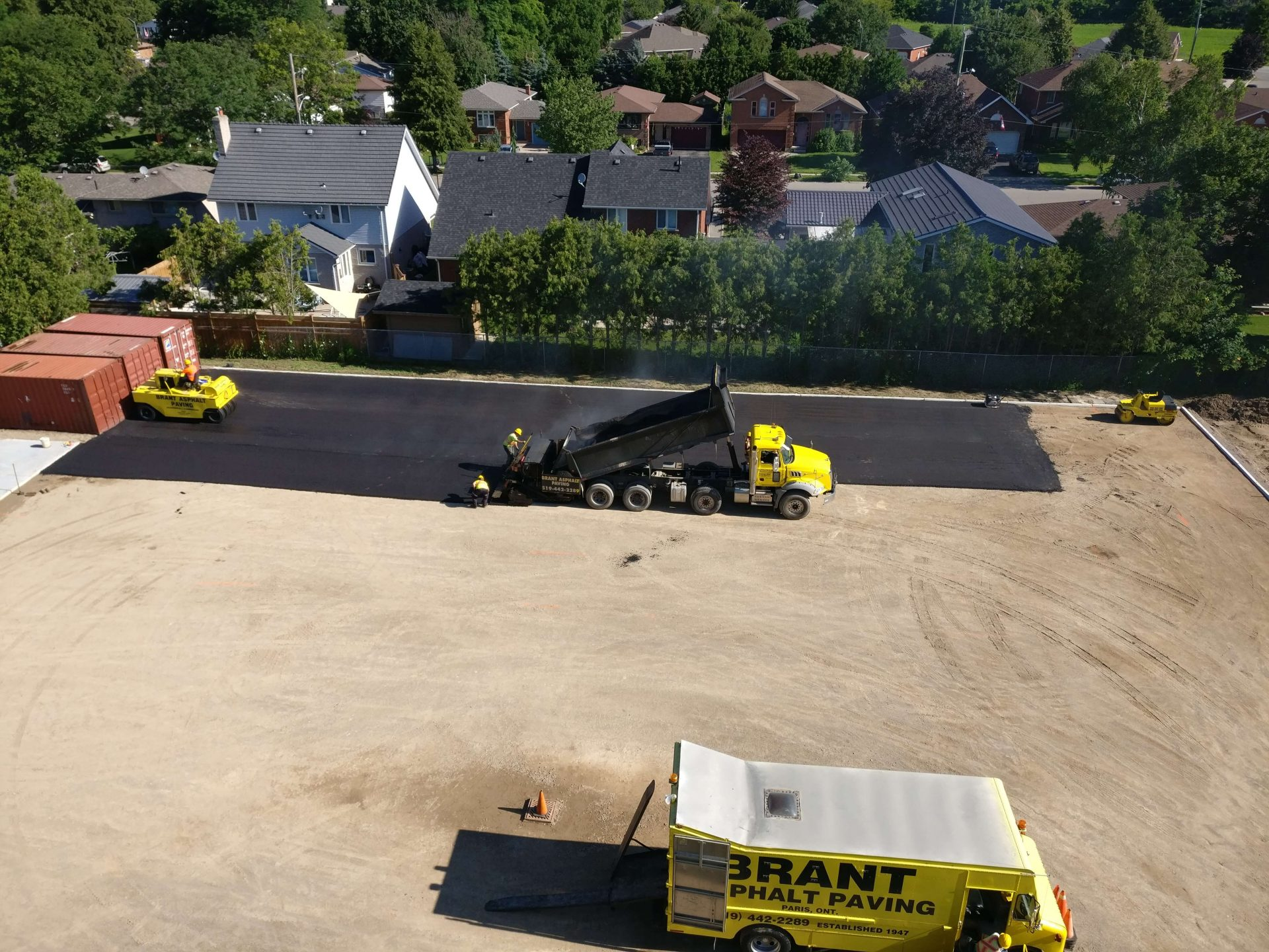 Asphalt paving with trucks