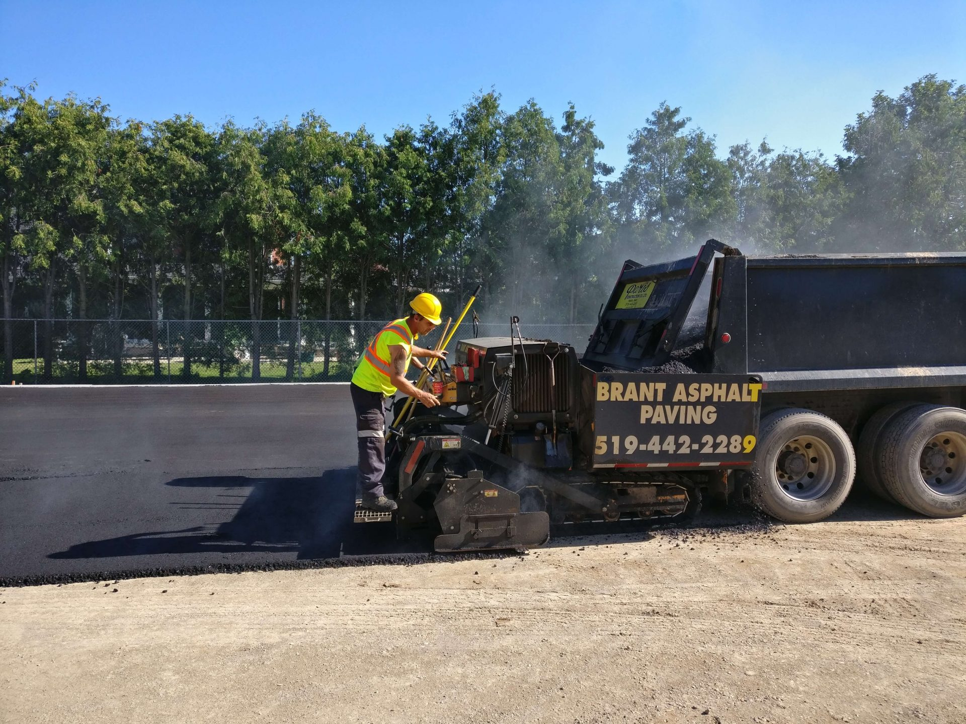 Asphalt pavers on construction truck