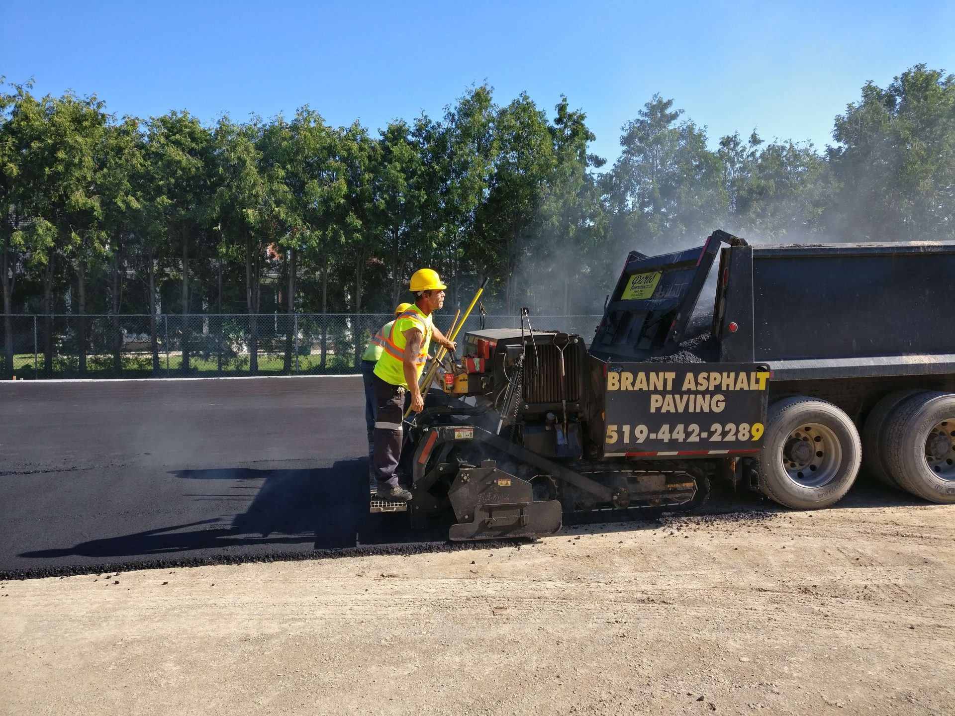 Paris Construction Pavers on asphalt truck