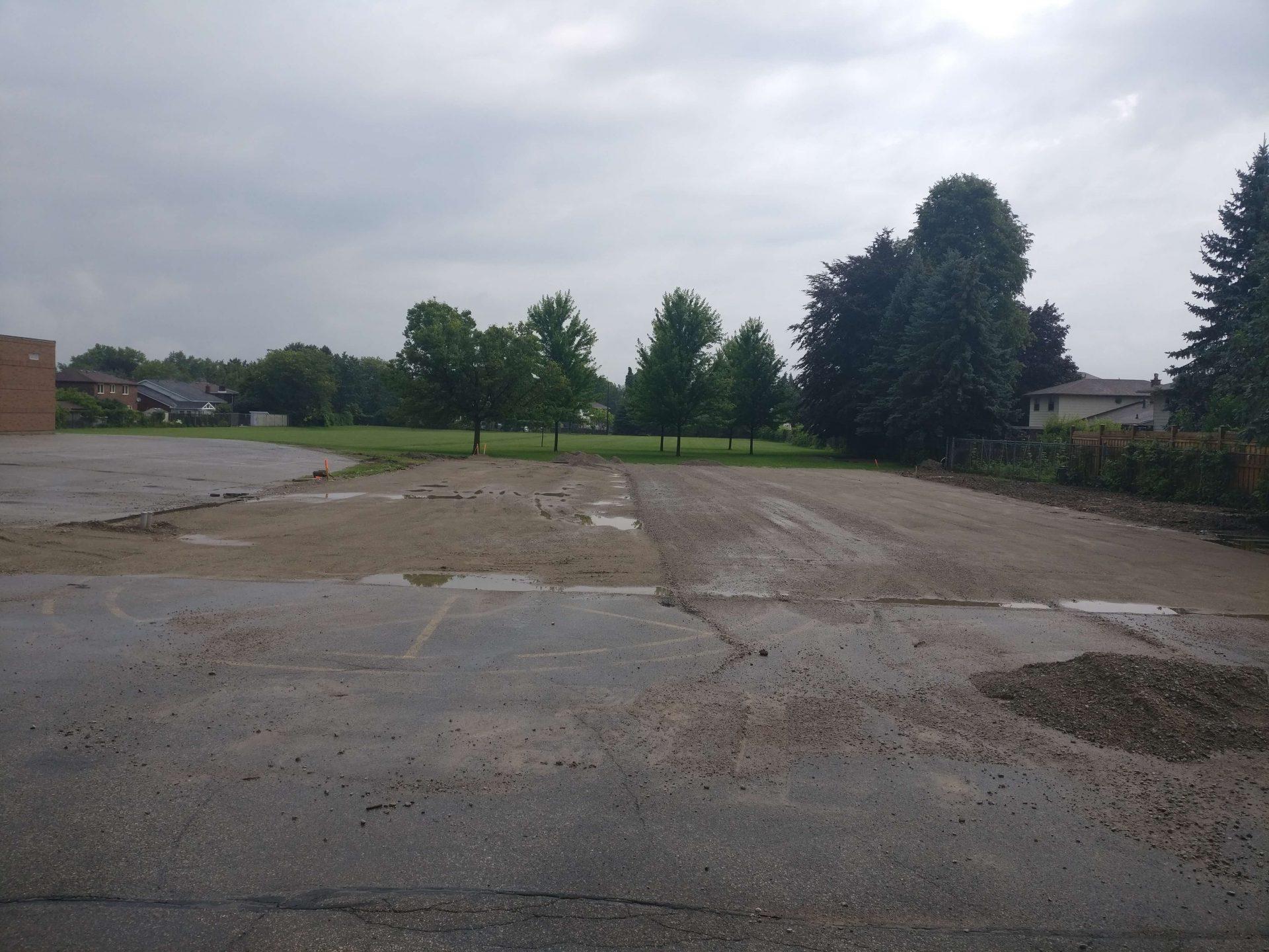 unpaved gravel parking lot