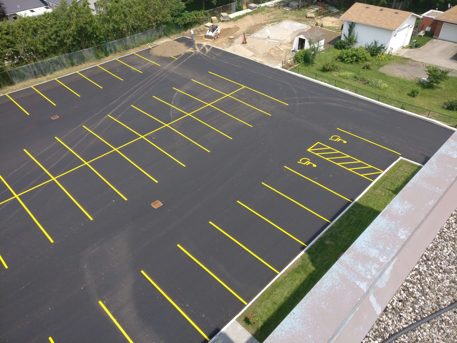 finished parking lot with handicap spaces