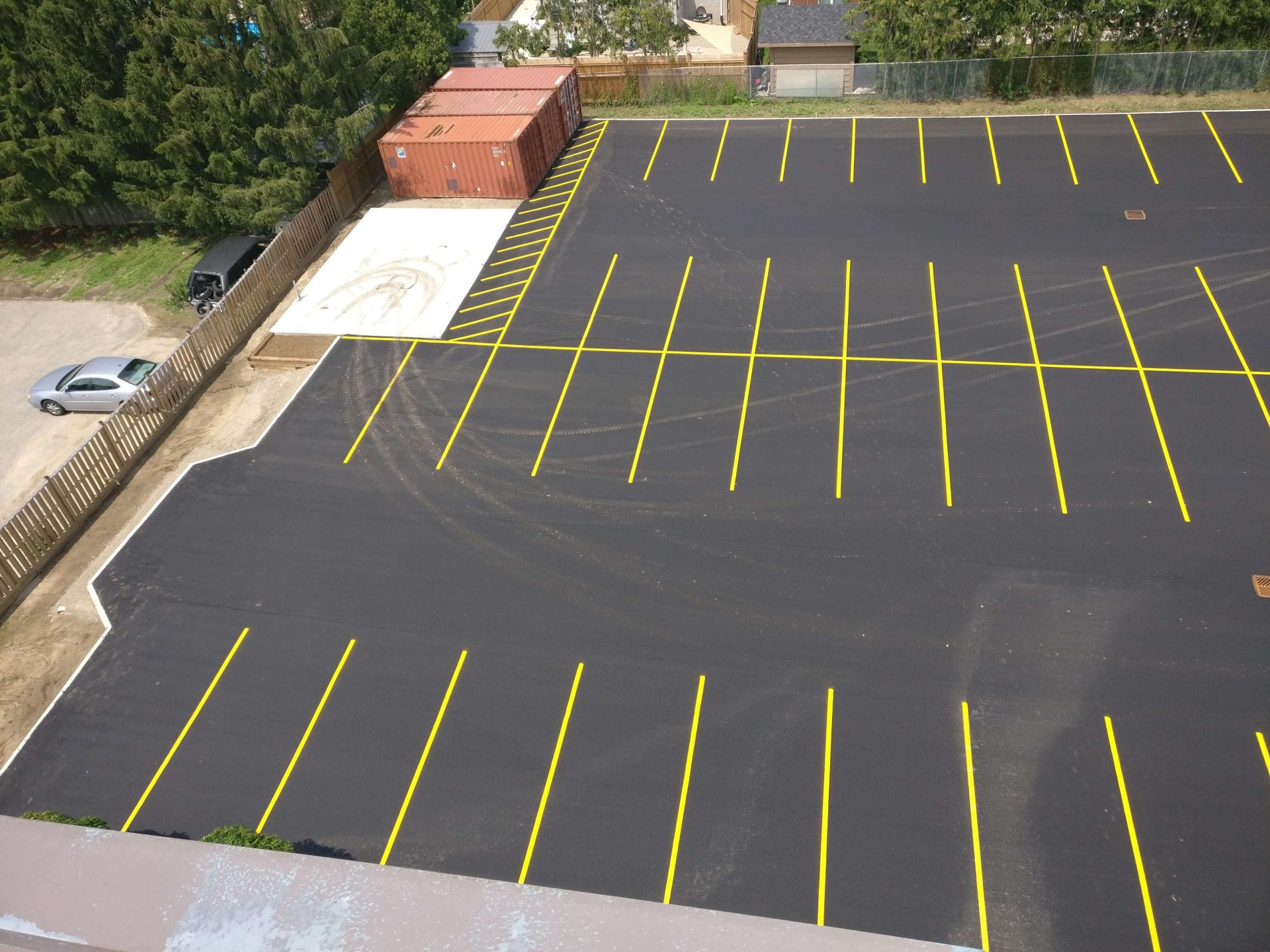 paved parking lot with yellow lines