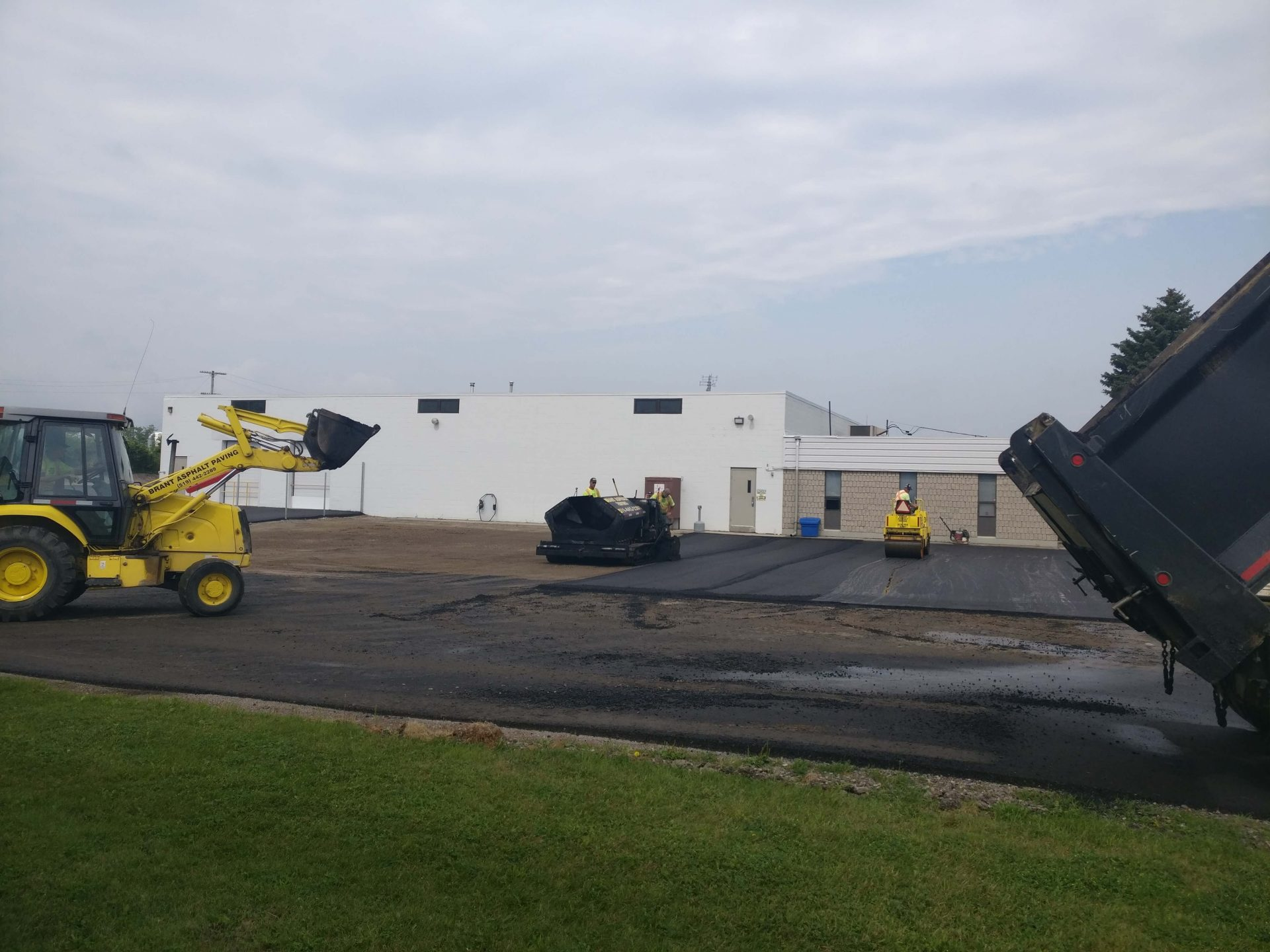 Laying down asphalt by Paris Construction