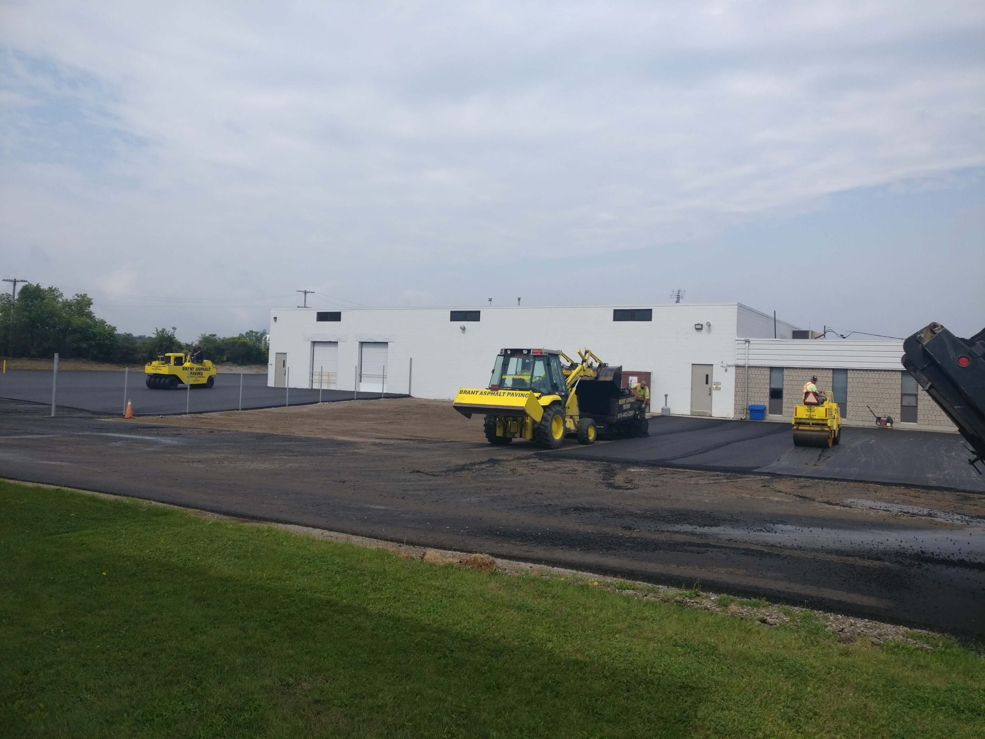 rolling asphalt for parking lot by Paris Construction