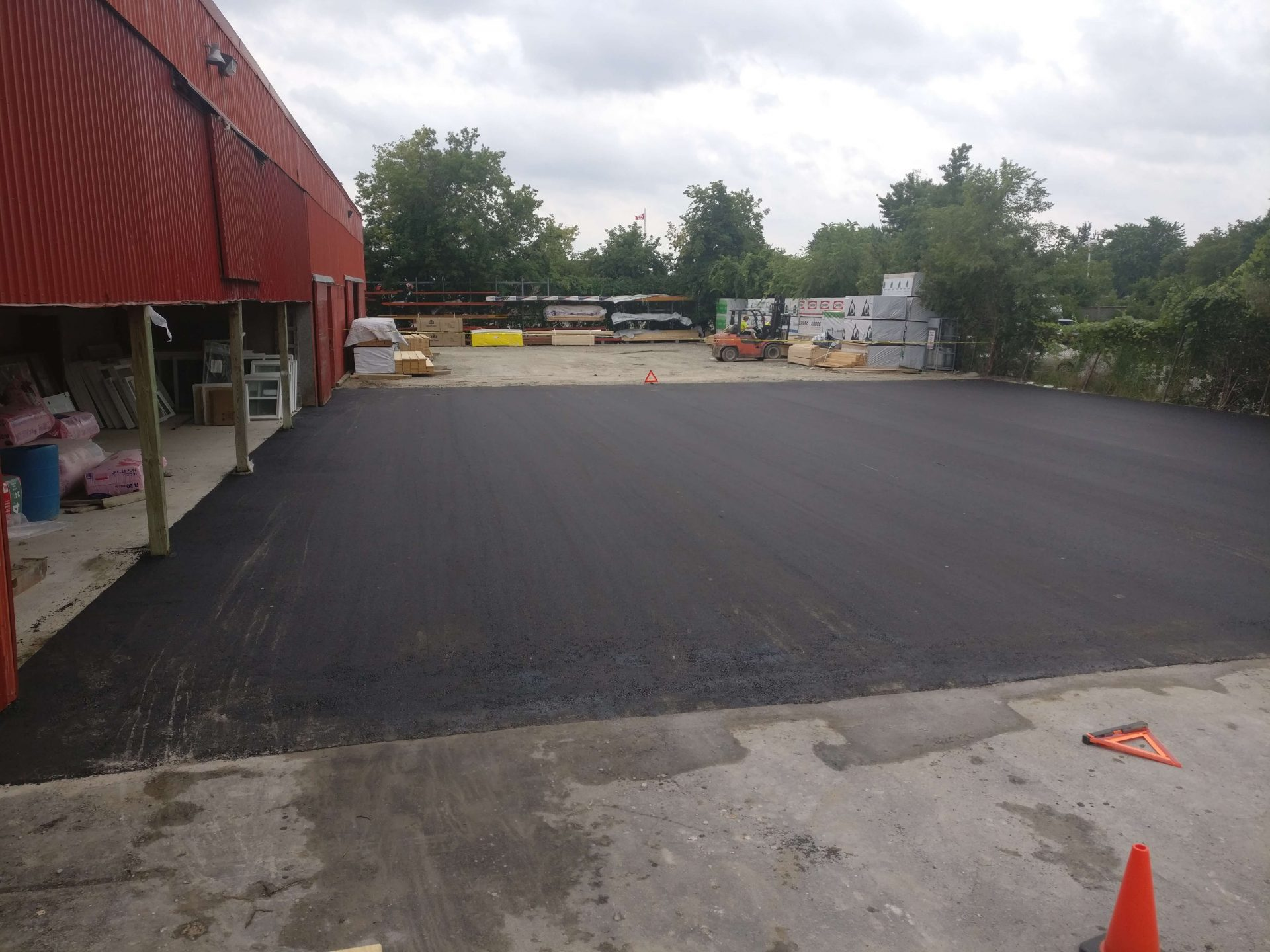 paved asphalt outside of garage