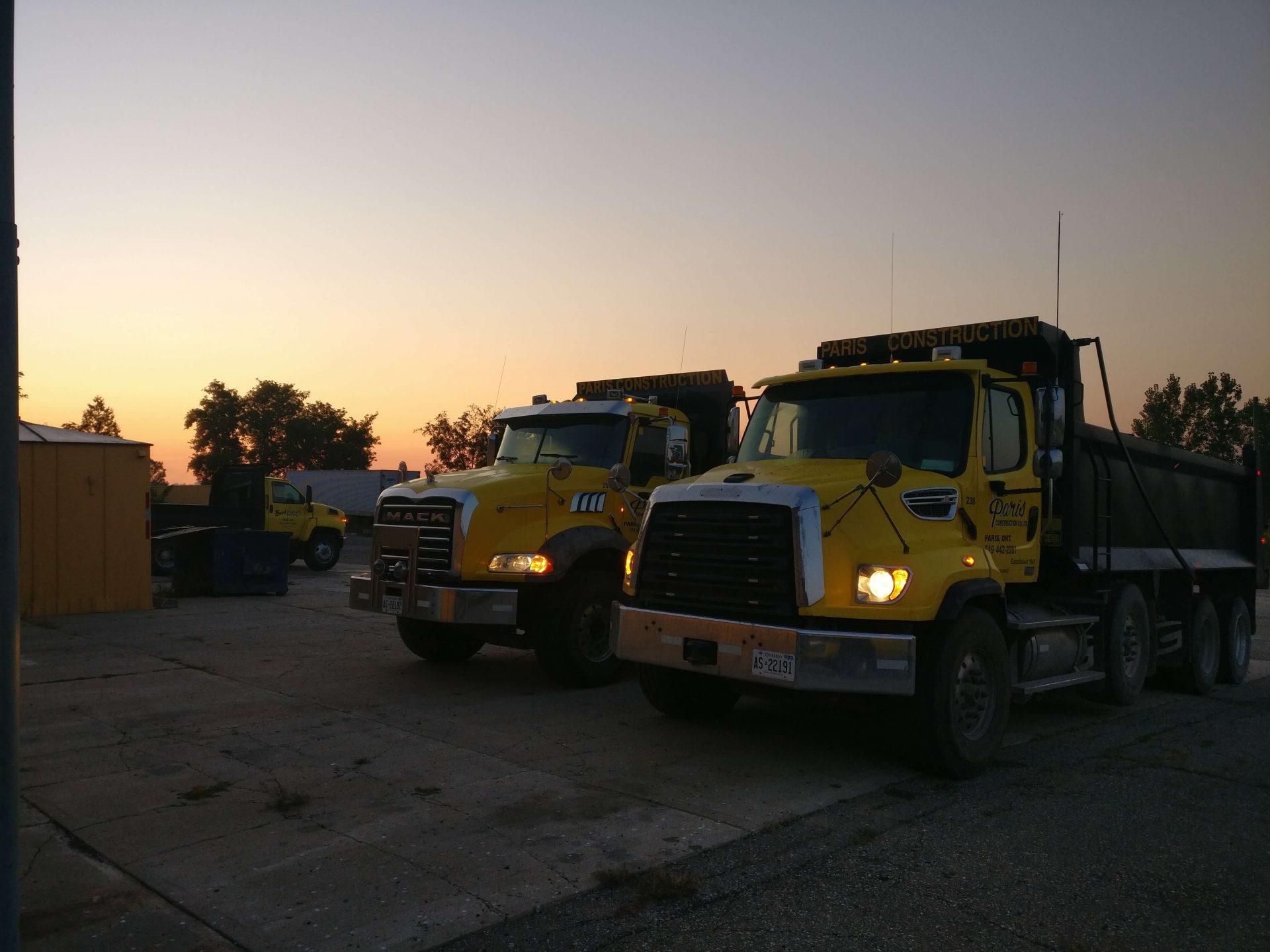 Paris Construction dump trucks at night