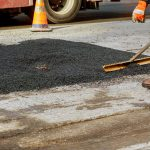 Asphalt preventive maintenance is done by construction worker